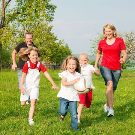 Family Running in a field