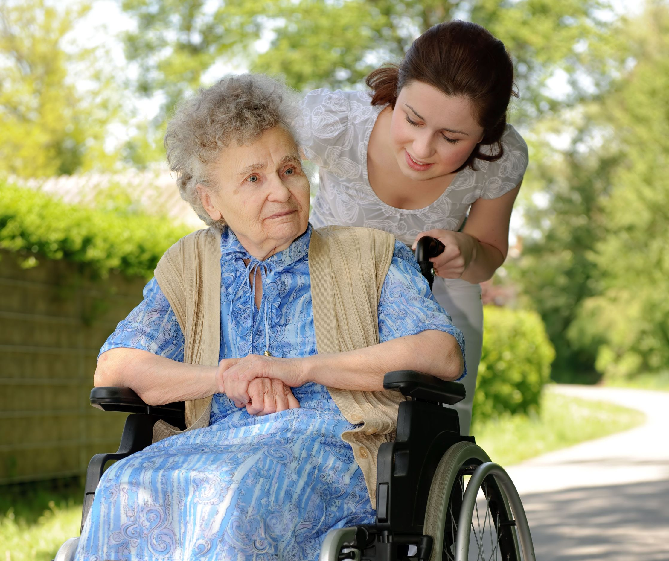 Elder Lady being pushed in wheelchair